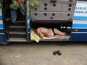 Drunk Backpacker Sleeping Inside the Bus Cargo
