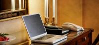 Laptop on desk in hotel travel