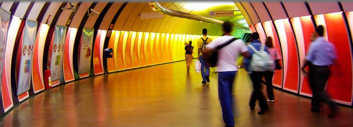 People in a colorful tunnel