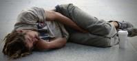 Backpacker sleeping on street