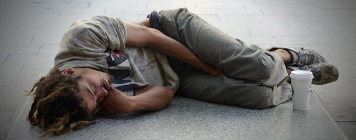 Backpacker sleeping on street