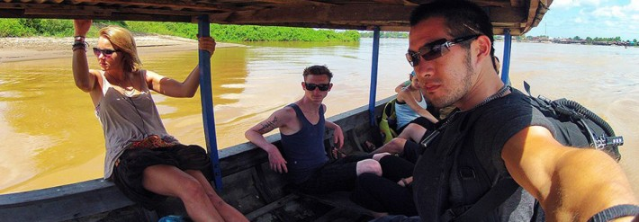 Backpackers in Laos Boat