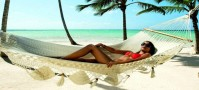 Girl on hammock on beach