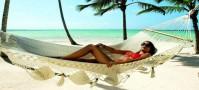 Girl on hammock on beach
